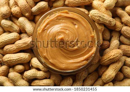 Jar with peanut butter on peanut background, close up Foto stock ©
