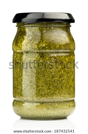 Jar with pesto sauce isolated on the white background