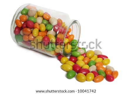 Jar with spilling jelly beans, isolated on white background