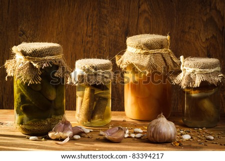 Jar with vegetables and mushroom in basement