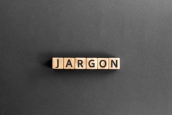 Jargon  - word from wooden blocks with letters,  special words and phrases jargon concept, top view on grey background