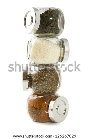 Jars filled with herbs isolated over white