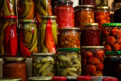 Jars of pickles. Pickled tomatoes, cucumbers and peppers. Russian traditional cusine.