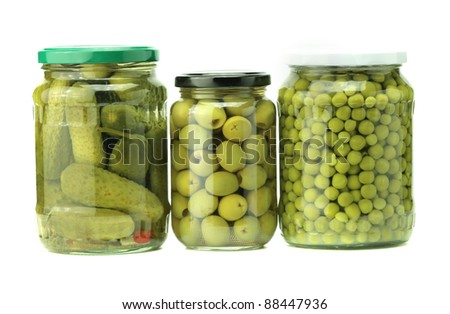 jars of preserved food isolated on white