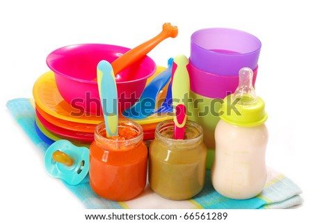 jars of various baby food and bottle of milk isolated on white
