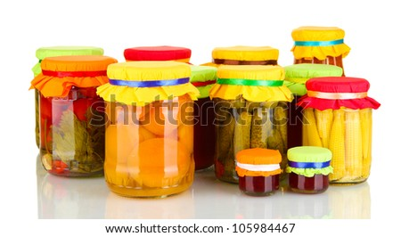 Jars with canned fruits and vegetables isolated on white