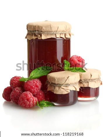 jars with jam and ripe raspberries with mint isolated on white - stock photo