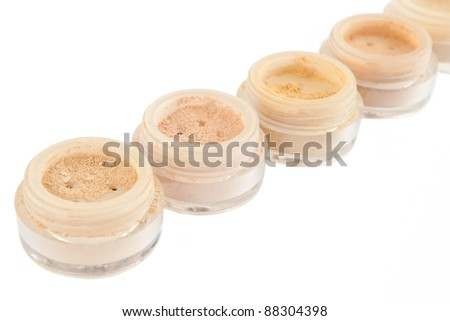 jars with make-up powder, blush, rouge, eye hadows isolated over white