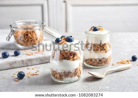 Jars with yogurt, berries and granola on  table ストックフォト ©
