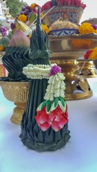 Jasmin and rose garland on top of banana leaf cone as oblatio  on sacrified altar in religious ceremony in Thailand