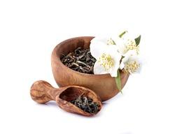 Jasmine flowers and green tea  on a white background. Green tea with jasmine. Herbal medicine.