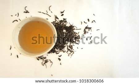 Jasmine green tea in tea cup on white background. #1018300606