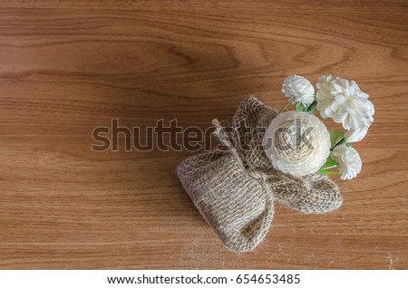 Jasmine in a sack bag, on old wooden table background. beautiful flower and meaningful on Mother's Day. #654653485