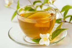 Jasmine tea and Jasmine flowers on a white background