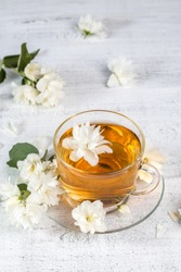 Jasmine tea in a cup on a wooden background.