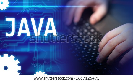 Java. Hands of the programmer. Using Java technology create a site. Programming with javascript. Creation of software. Java logo on computer background. Circuit board conductors on a blue background Foto stock ©