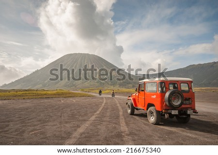 Java Indonesia-Arpi l 25 2010 Tourists 4x4 Jeep for tourist rent at Mount Bromo The active Mount Bromo is one of the most visited tourist attractions in East Java Indonesia