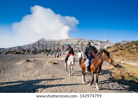 JAVA INDONESIA-AUGU ST 11 Indonesia man with the horse for tourist rent at Mount Bromo on August 11 2009 in Java Indonesia.Mt Bromo is an active volcano and part of the Tengger massif in East Java