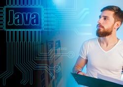 Java programmer. A man looks at the Java logo. Website development. Writing a program. Concept - a person recalls the programming language. Concept - Java Developer Search. Junior Developer