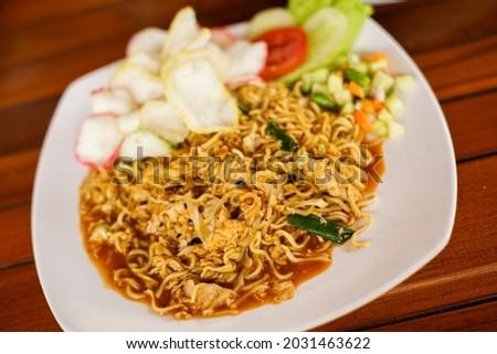 Javanese noodle (mie goreng tek tek) on a plate Stok fotoğraf ©