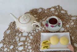 Javanese tea time with traditional favourite cakes, bakpia. With doily crochet background. Selective focus.