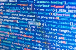Javascript code in bracket software. Programmer typing new lines of HTML code. Script procedure creating. Big data database app. Website codes on computer monitor.
