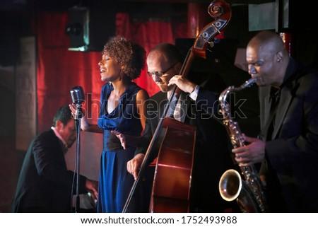 Jazz band performing in nightclub Stock photo ©