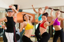 Jazzdance - young people dancing in a studio or gym doing sports or practicing a dance number
