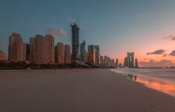 JBR Beach Dubai and skyline at sunset.