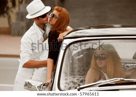 jealous girl in a retro car.