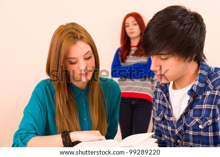 Jealous girl watching her classmates