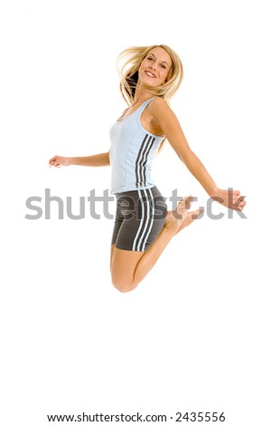 Jeanne-Marie jumping with joy in her gym outfit