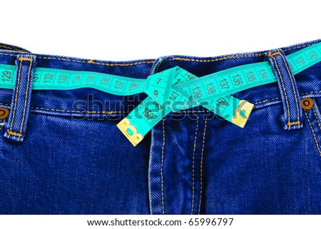Jeans and measuring tape - sliming, isolated on white background - stock photo