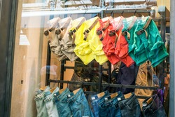 jeans and multicolored shorts for a glass window storefront