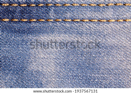 Jeans background. Denim fabric with seams close-up. Сток-фото ©
