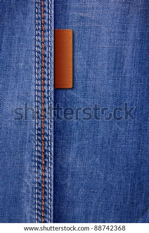 Jeans background with leather inserts