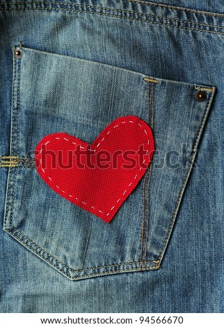 Jeans background with red heart