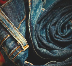jeans constricted into a roll in the storefront