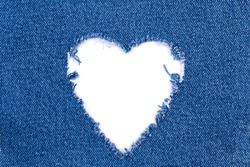 Jeans Heart Frame Hole. Destroyed torn denim blue jeans frayed flap patch fabric on white background