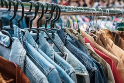 Jeans jackets and retro shirts on second hand market /  flea market - vintage clothing -