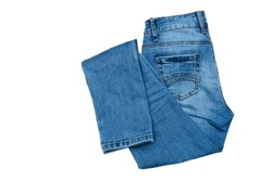 jeans on the background, blue jeans lie on a wooden background,