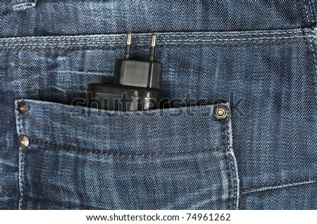 Jeans pocket closeup with electric plug