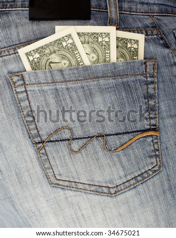 Jeans rear pocket with $1 bills
