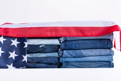 Jeans stack on a white background in store and supermarke and flag USA.concept fashion dress jeans.
