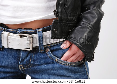 Jeans, t-shirt and leather jacket detail