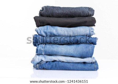 Jeans trousers stack and space for text on white background #1241436151