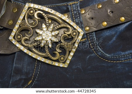 Jeans with a belt decorated with rhinestones