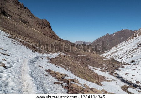 Jebel Toubkal winter ascent highest summit in northern africa in high atlas mountains in morocco #1284196345