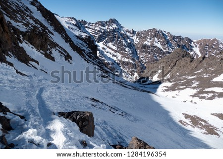 Jebel Toubkal winter ascent highest summit in northern africa in high atlas mountains in morocco #1284196354