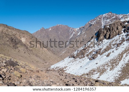 Jebel Toubkal winter ascent highest summit in northern africa in high atlas mountains in morocco #1284196357